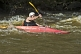 Image of Canoeist in red Dagger kayak negotiates rapids.