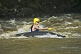 Image of Canoeist in red Dagger kayak negotiates some rough water.