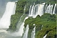 Multiple waterfalls and jungle at the Iguazu Falls.
