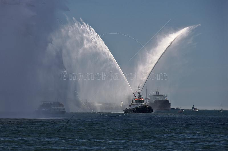 The tugboat 'Atlantic Oak' shows off its fire fighting spray in Halifax harbor.