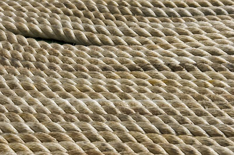 Lines of white rope stacked close together.