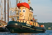 Canada, Nova Scotia, Pictou. Visitors to Pictou Docks take a harbour trip on the tugboat 'Theodore Too'.
