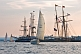 Yachts race past moored tallships in Pictou Harbour.