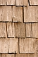 Detail of an ancient wooden shingled barn wall.