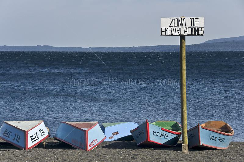 Rowing boats on the beach of Lago Villarrica.