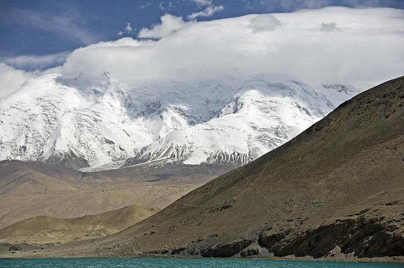 Snow-capped Pamir Mountains next to Karakul Lake, on the Karakoram Highway between Kashgar and Tashkurgan.