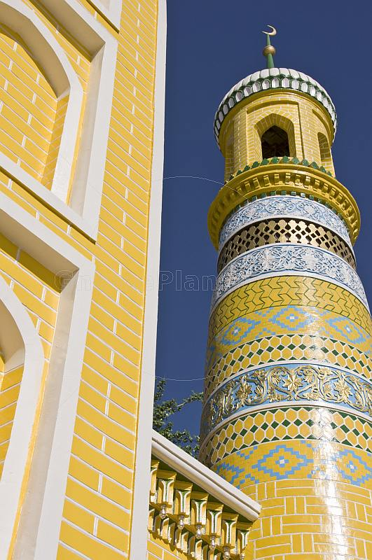 The yellow-tiled Id Kah Mosque and Minaret, dating from 1442, dominates the old town.