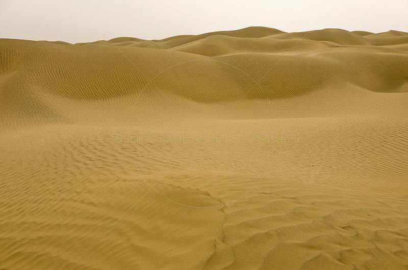 Taklamakan desert and sand dunes on the highway from Niya to Luntai.