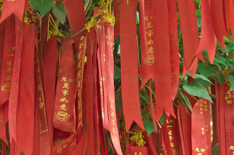 Red and gold Good-Luck banners at the Great Buddha Temple.