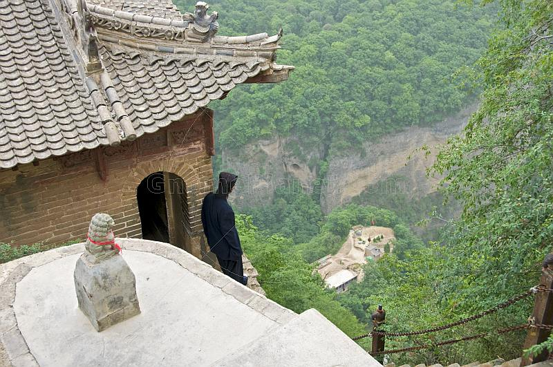 Taoist monk looks down from the Kongtong Shan Monastery, near Pingliang.