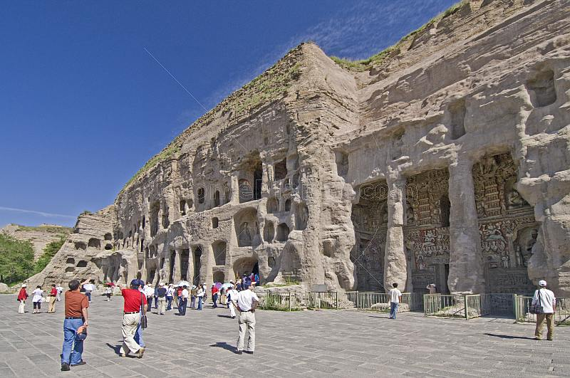 Chinese tourists visit the Yungang Buddhist caves, near Datong.