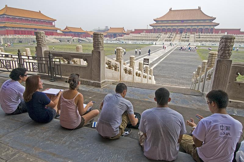 A group of Chinese art students draw tourists at the Hall of Supreme Harmony in the Forbidden City.