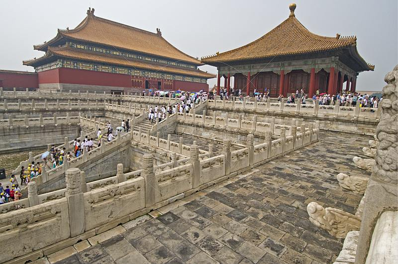 Chinese tourists climb the stairs to the Hall of Preserving Harmony at the Forbidden City.