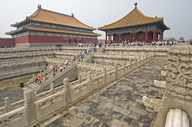 Chinese tourists climb the stairs to the Hall of Preserving Harmony in the Forbidden City.
