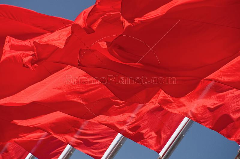 Red flags for the Peoples Republic of China billowing in the wind of Tiananmen Square.