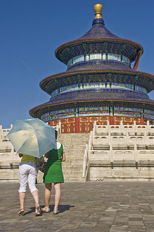 Two Chinese girls visit the Hall of Prayer for Good Harvests at the Temple of Heaven.