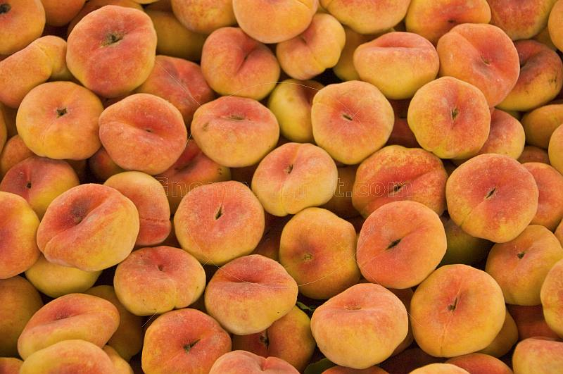 Flat Peaches for sale at the Huguosi Market.