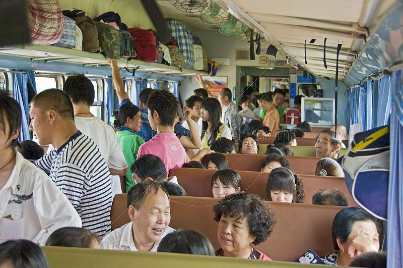Chinese travellers on a crowded train from Beijing to Datong.