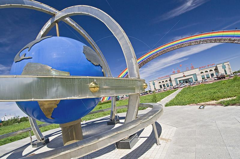 Globe and rainbow arch greet the visitor arriving at the Erlian Border Crossing post.