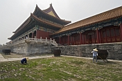 Gardeners clean the paths outside the Gate of Supreme Harmony in the Forbidden City.