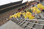 Chinese school-children in yellow teeshirts visit the Forbidden City.