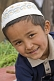 Small Muslim boy in skullcap at the Sunday Animal Market.