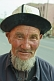 Elderly Uighur man with hat and beard.