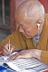 Deaf monk writing at the Gao Temple.