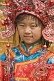 Small Chinese girl poses for photograph in replica Imperial Court clothes.
