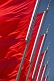 Red Chinese flags for the Peoples Republic of China billowing in the wind of Tiananmen Square.