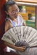 Chinese girl with white paper fan in Jingshan Park.