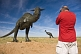 Canadian tourist in red teeshirt photographing dinosaur statues near the Monolian border.