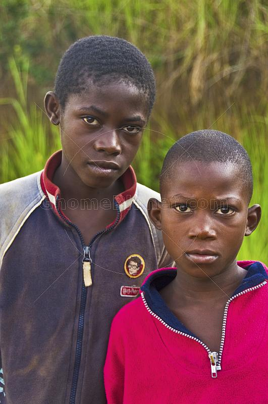 Portrait of two Congolese boys with background of tall grass.