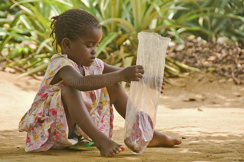 Young Congolese girl with a plastic bag.