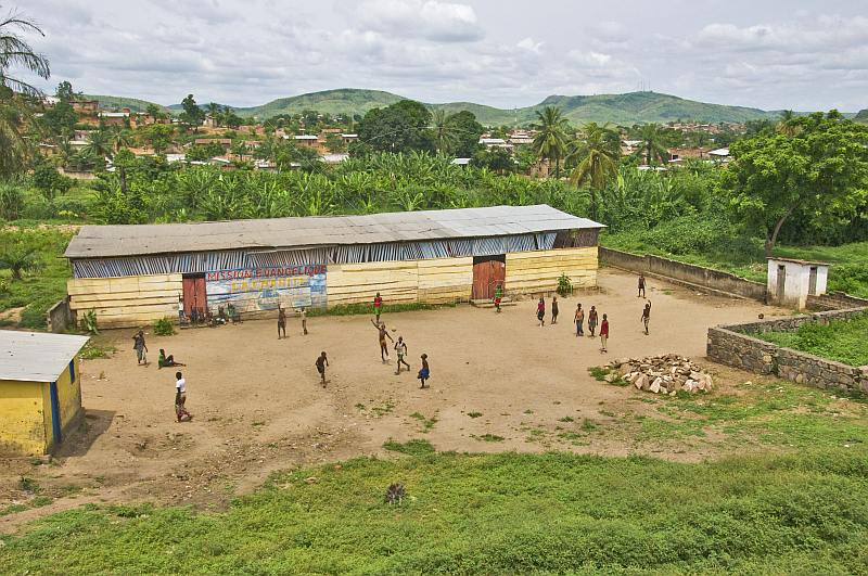 Small boys play football in the playground of the Mission Evangelique School.