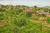 Vegetable and banana plots across the river from brick and corrugated iron houses in central Boma.