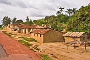 A small roadside village of mud-brick houses.