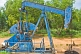 A nodding-donkey pumpjack extracts crude oil from the ground.