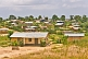 Image of A jumbled village of shacks with corrugated iron roofs.