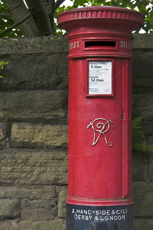 Red pillar mail Victorian post box made by Andrew Handyside and Company iron foundry in Derby.