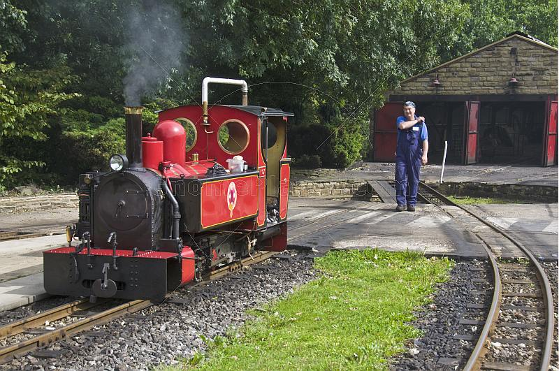 Steam locomotive driver walks towards engine Fox at Kirklees Light Railway at Clayton West.