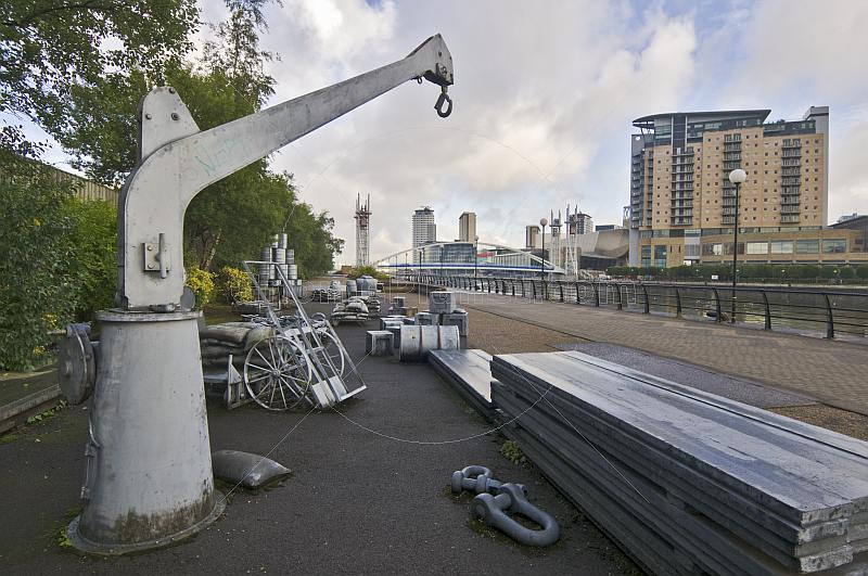 The Silent Cargoes sculpture by artist James Wine at the side of Salford Quays on Manchester Ship Canal.