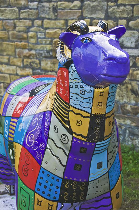 Flock to Skipton sheep sculpture with colored decoration on the Leeds Liverpool canal.