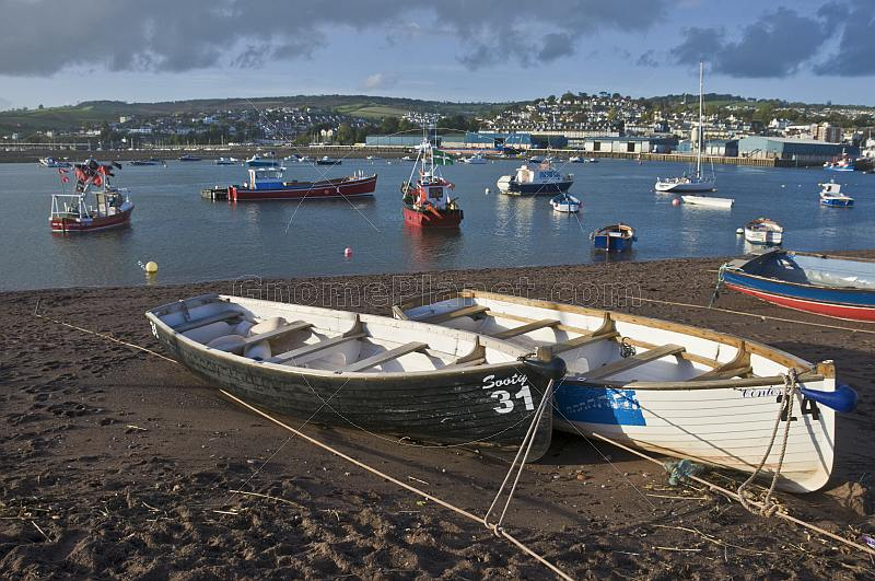 Fishing boats in Teignmouth harbor and the River Teign estuary.