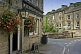 Elephant and Castle public house with hanging flower baskets on Lower Mill Lane Holmfirth.
