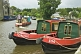 Narrow boats on the Leeds and Liverpool Canal at the Belmont Street Wharf.